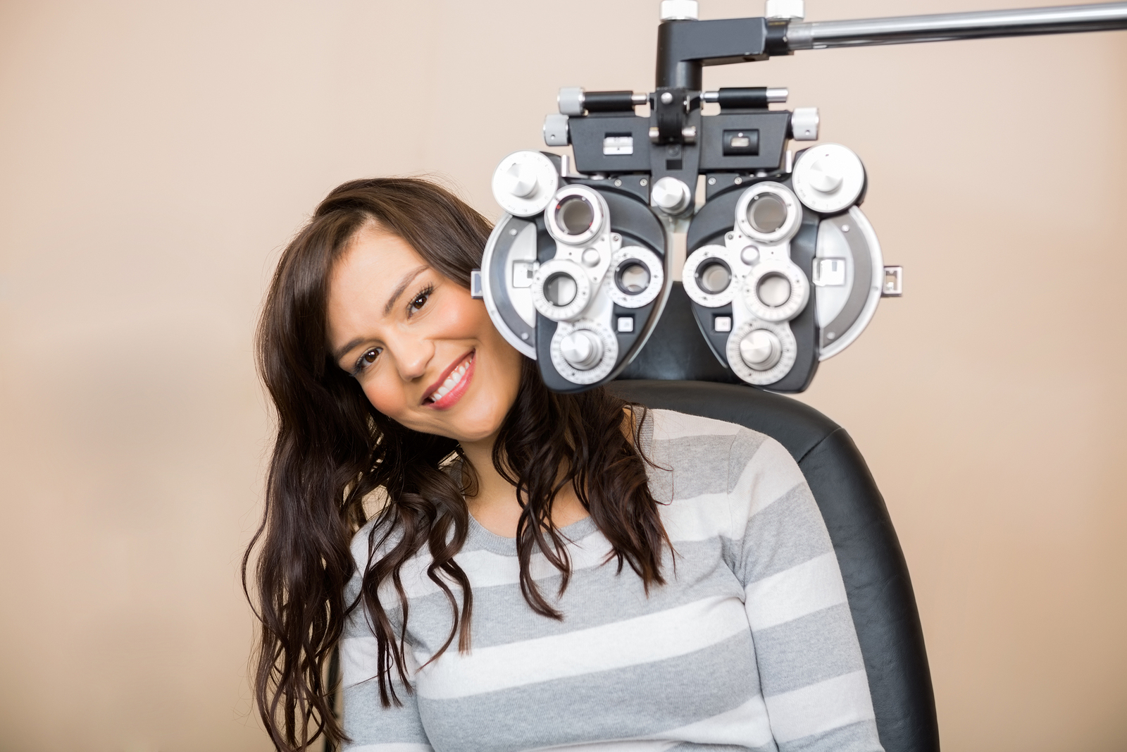 Woman sitting in front of eye exam