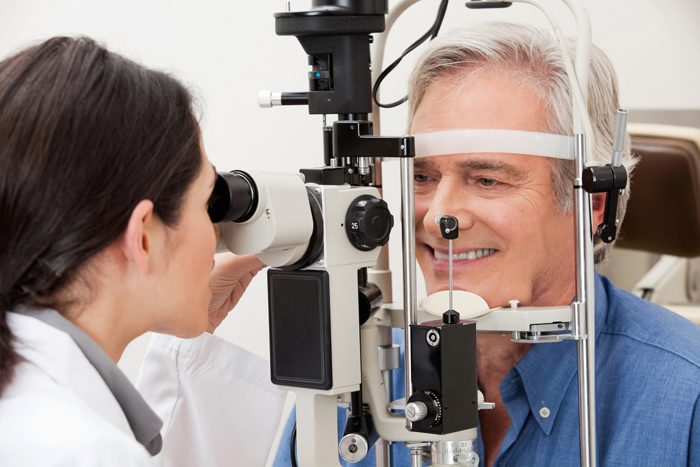 man getting examined for cataracts